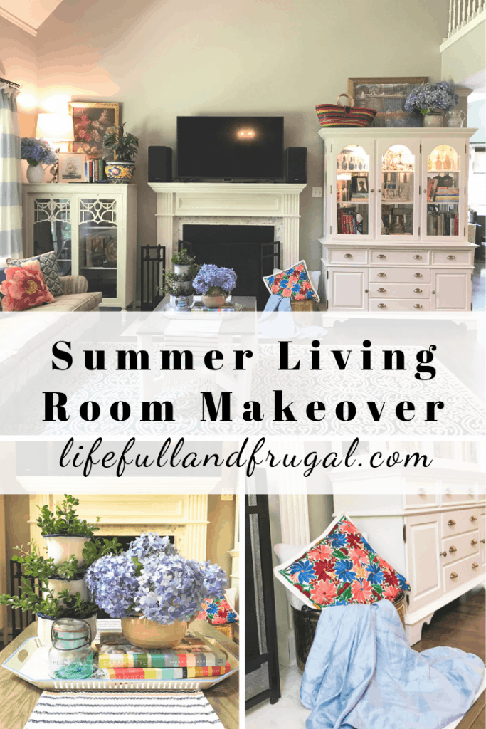 Life Full and Frugal / Summer Living Room Makeover / Vaulted ceilings, neutral colors on the walls with white trim, marble tiled fireplace flanked by a white book case with glass doors to the left and a white china cabinet to the right. Lots of colorful accents from blue hydrangea floral arrangements, Mexican textiles and pottery, floral throw pillows, a print of Monet and a painting of a floral arrangement. Coffee table dressed with a vintage tray, stacked pottery with greenery, design books, vintage blue jar and an arrangement of fresh blue hydrangeas. #summerlivingroommakeover #livingroomdecor #livingroominspiration #livingroommakeover #howtoaddcolor #livingroomrefresh #addcolortoyourroom #summerlooks #vacationvibesathome #affordabledecor #playwithcolor #diydesign #diydecor #prettyspaces #lifefullandfrugal #interiordesign #diyinteriordesign #housebeautiful #mybhghome