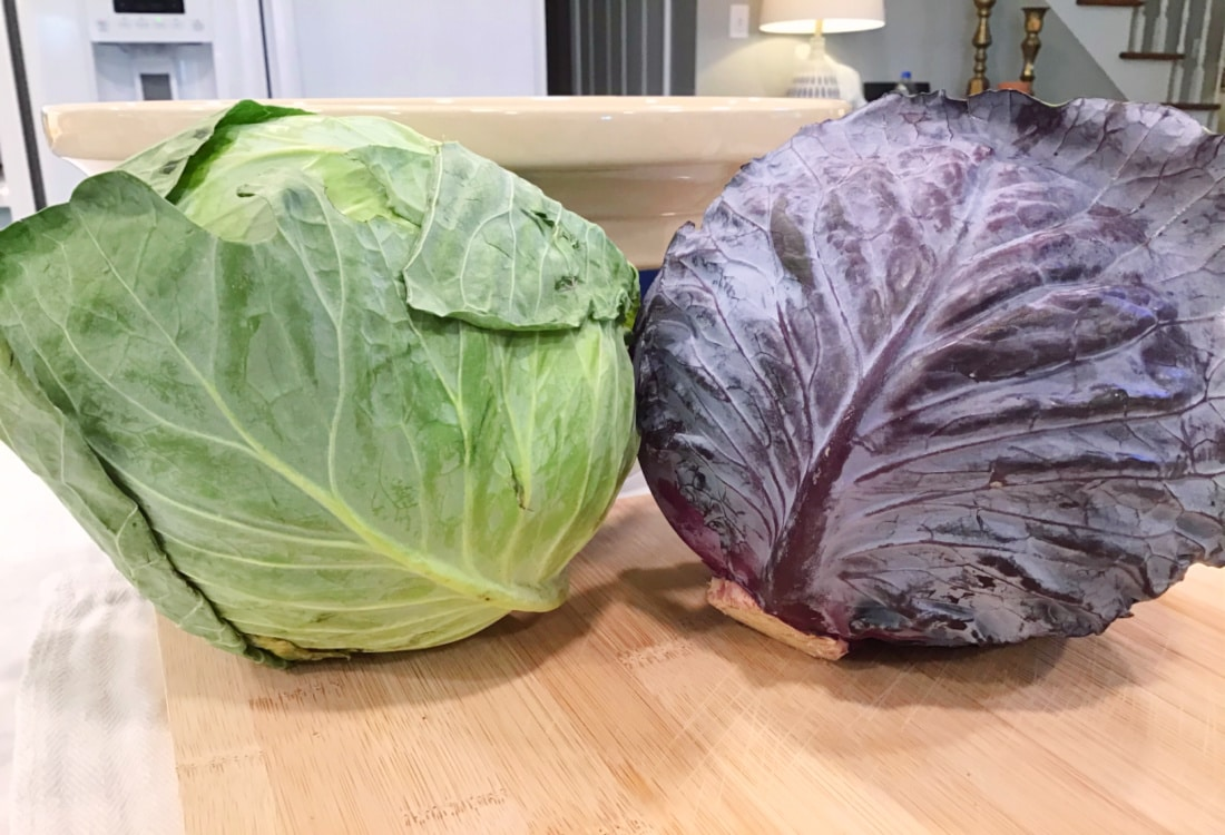 Simple Lacto-Fermented Sauerkraut - Life Full and Frugal - green and red cabbages placed on a bamboo cutting board