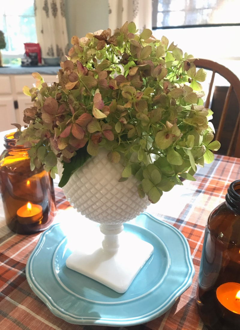 Creating Frugal Eclectic Fall Decor - Life Full and Frugal - milk glass vase with green hydrangeas