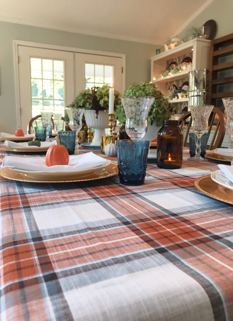 Creating Frugal Eclectic Fall Decor - Life Full and Frugal - White table cloth with orange and blue plaid pattern, decorated for fall