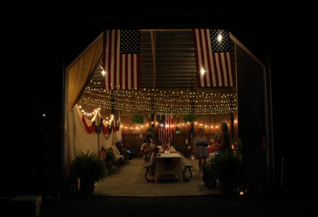 an evening view of a July 4th barn party life full and frugal