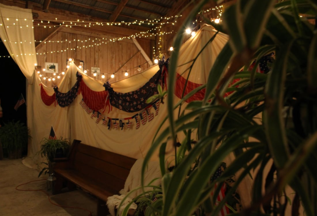 a July 4th barn party with bunting and Edison lights life full and frugal