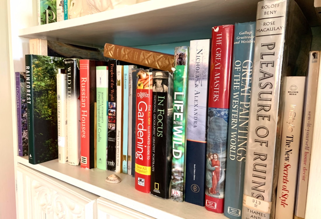 books on a white book shelf hygge home