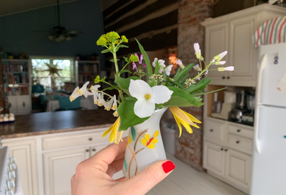 fresh cut wild flowers in a small white vase hygge home