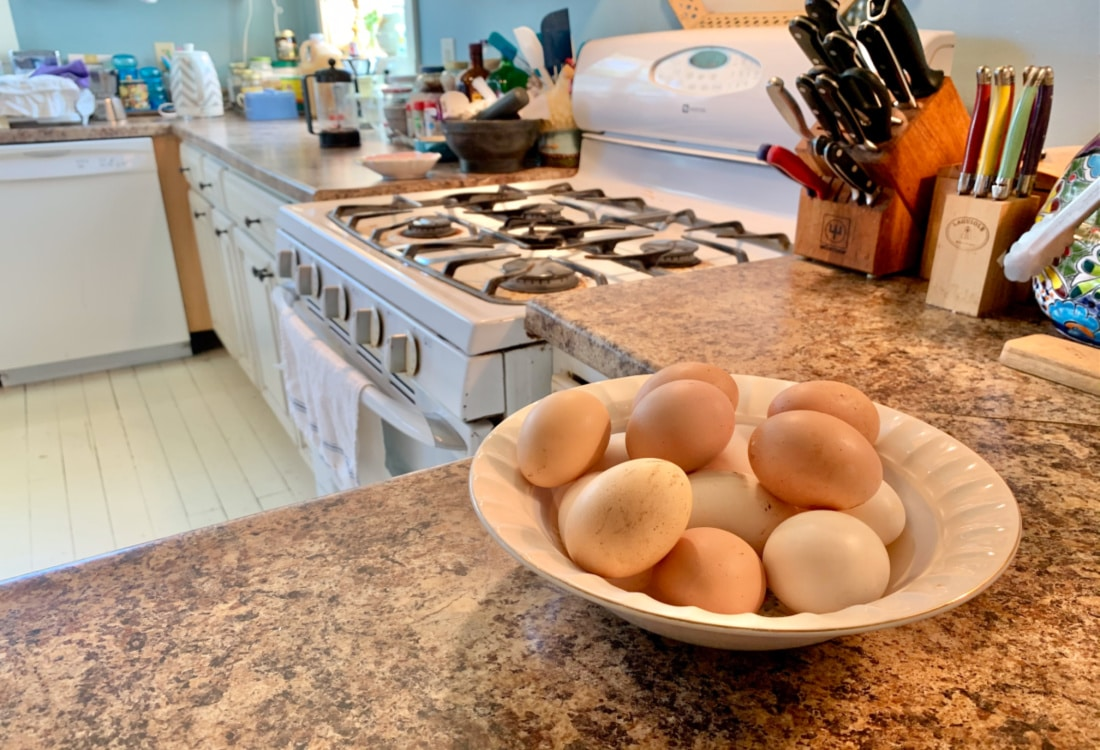 a bowl of fresh eggs on a kitchen counter hygge home