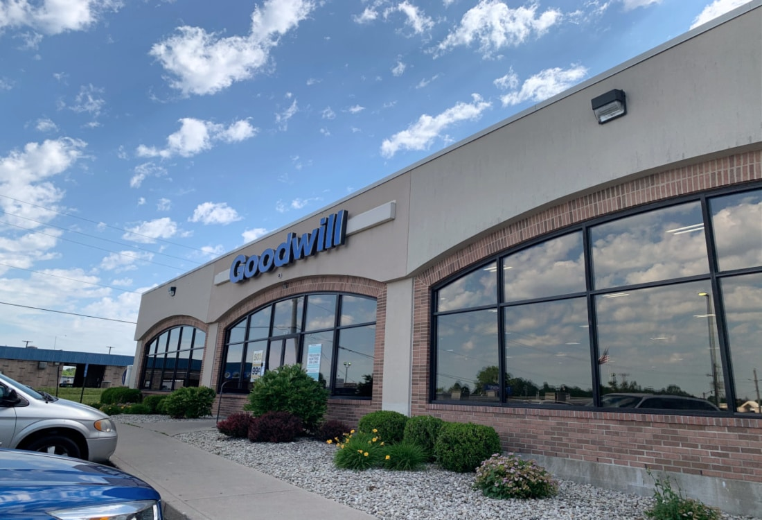 the front of a goodwill store life full and frugal
