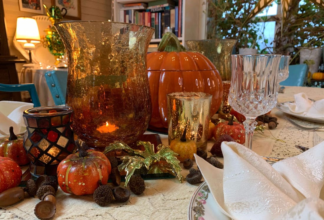 fall tablescape for thanksgiving candles and place setting