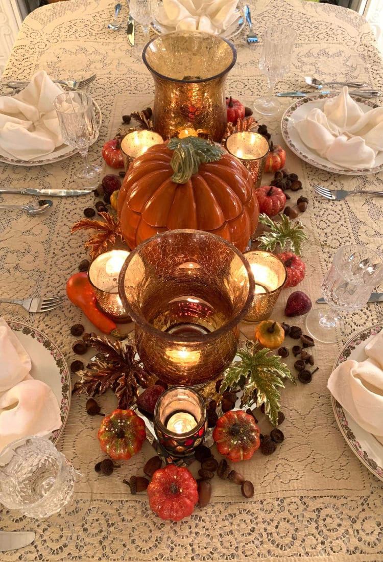 Autum tablescape with tea lights gourds and acorns