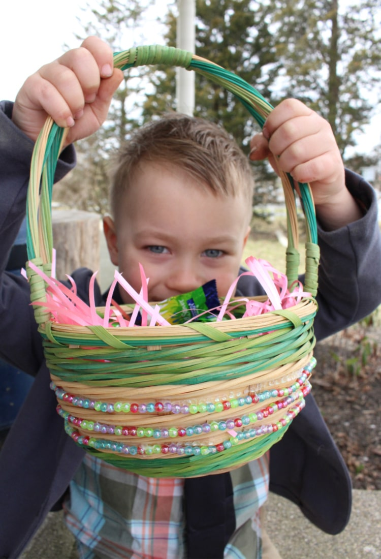 holding an easter basket of candy life full and frugal