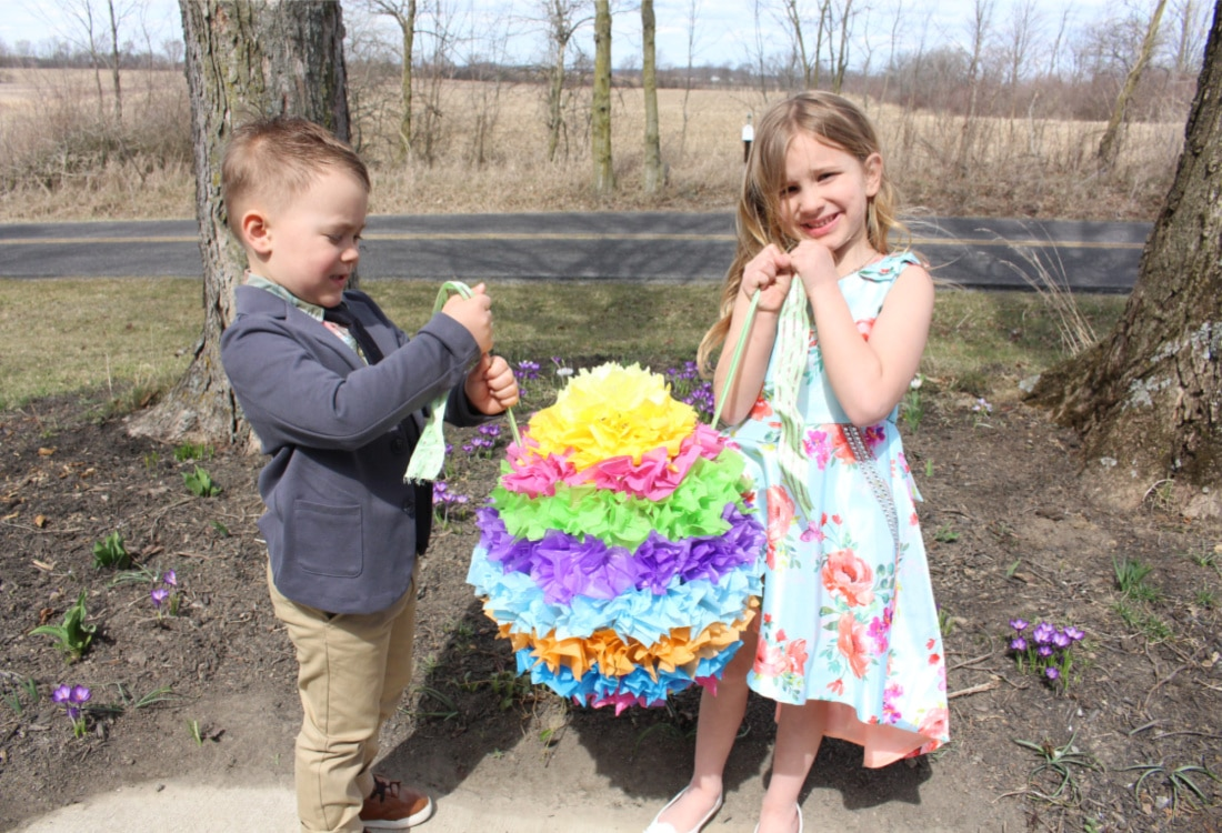 kids holding an easter egg pinata life full and frugal