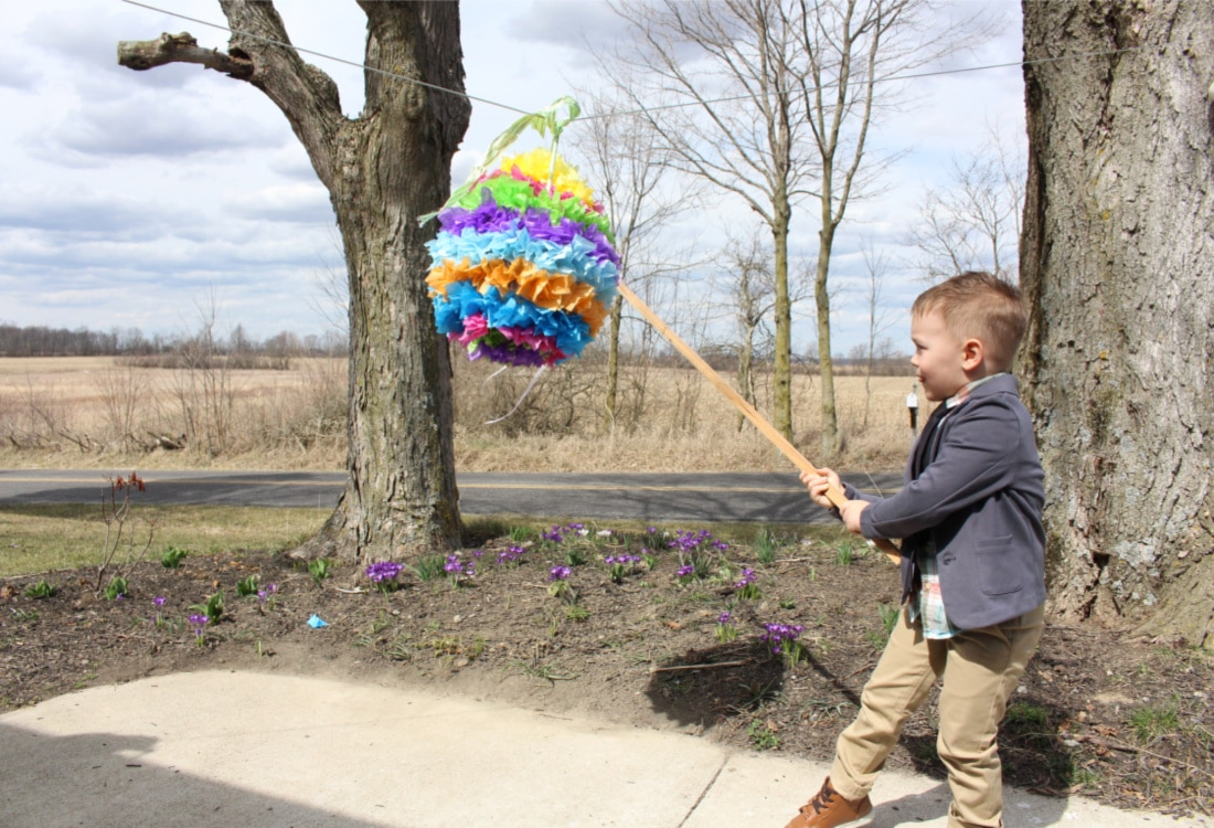 little boy hitting an easter pinata life full and frugal