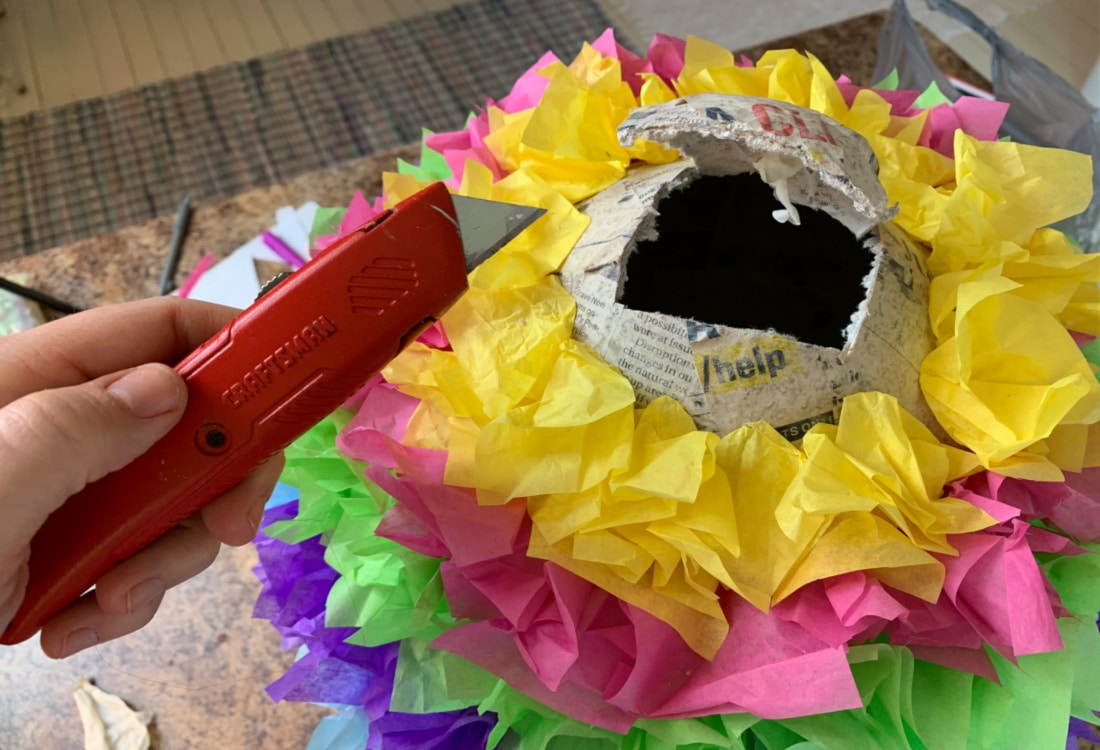 opening a pinata to add candy life full and frugal