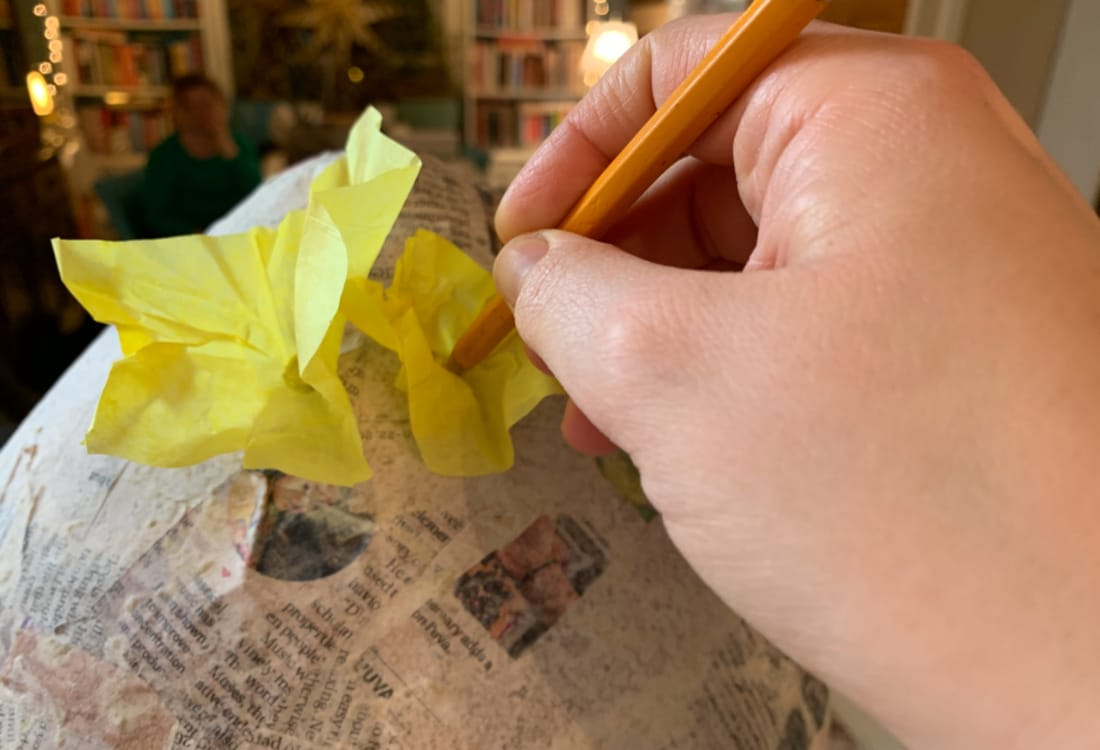 placing tissue paper on a pinata life full and frugal